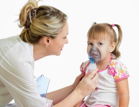 Doctor holding inhaler mask for kid girl breathing