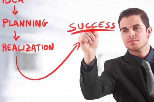 bigstock-Businessman-writing-a-business-26983652